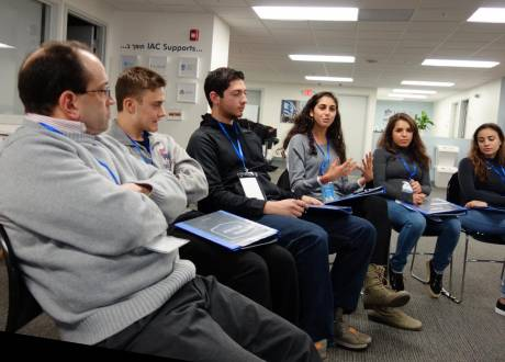 Students and facilitators from New Hersey sit in a roundtable within a classroom discussing how best to silence and censor facts Israel doesn't want the world to know.