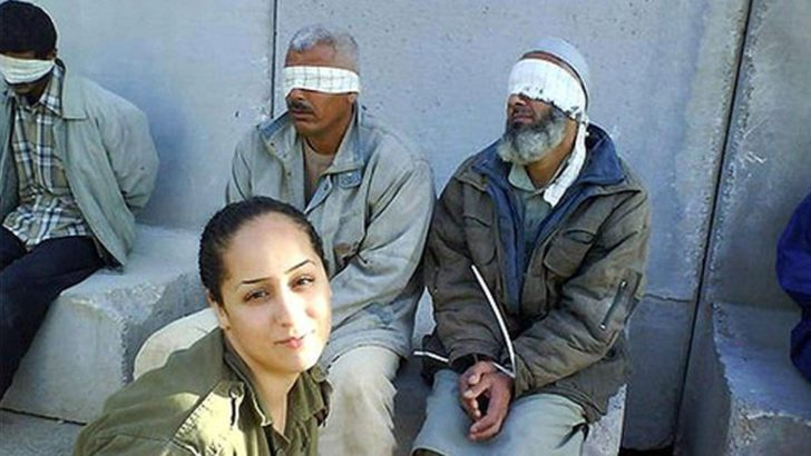 Israeli soldiers take 'selfie' with Injured Palestinian prisoners