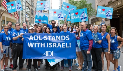 A group of people from the Anti-Defamation League displays a banner at 2017 New York City parade that states ADL STANDS WITH ISRAEL.