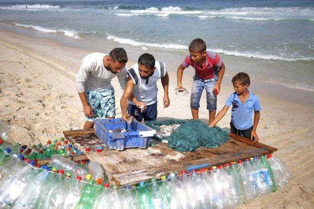Gaza fisherman battles poverty with plastic-bottle boat