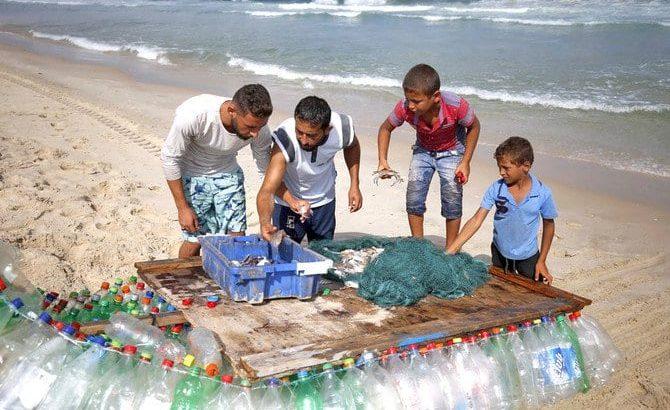 Gaza fisherman battles poverty with plastic-bottle boat