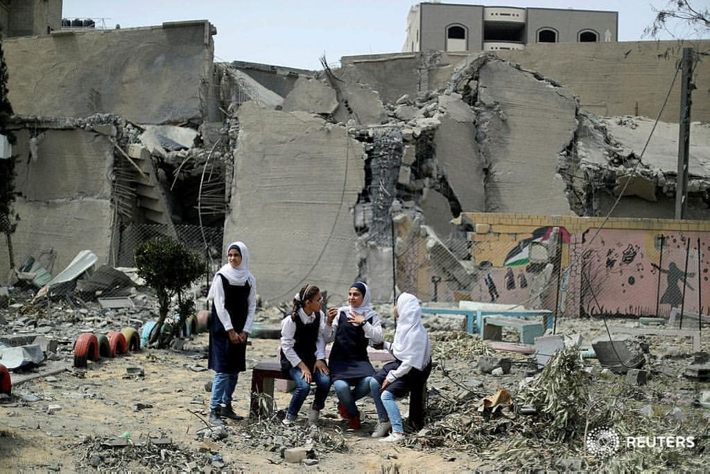 Palestinian students following Israeli airstrikes on Gaza City