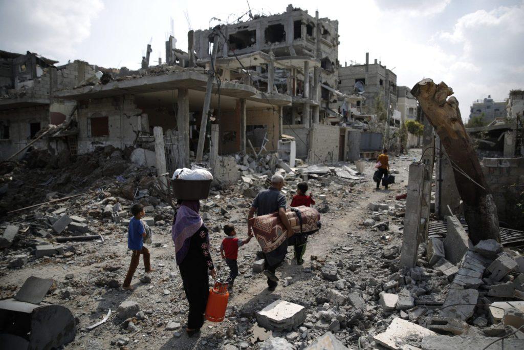Gaza family amid ruins 2014