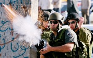 Israeli soldier fires a weapon. Candidates support Israel's right to defend itself.