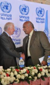 Presenting the UNRWA human rights curriculum to Pres. Jimmy Carter