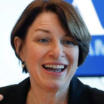 candidate Amy Klobuchar stands with Israel