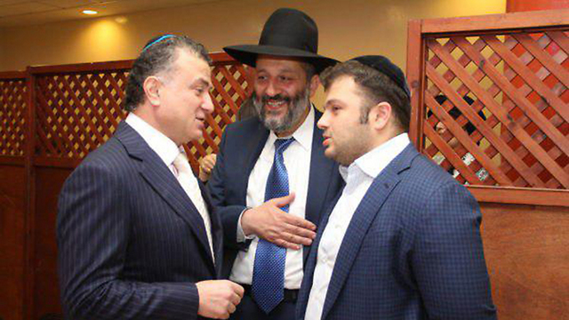 Billionaire Mikhael Mirilashvili and his son Yitzhakis with Israeli minister Yaffa Deri. The three were suspected of corruption.