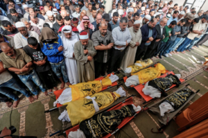 palestinians pray over bodies of those killed by Israel