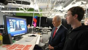 Then-President of Israel Shimon Peres and Facebook's Mark Zuckerberg launching Peres' international Facebook page, March 6, 2012.