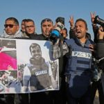 Palestinian journalists take part in a protest after the killing of fellow journalist Yaser Murtaja