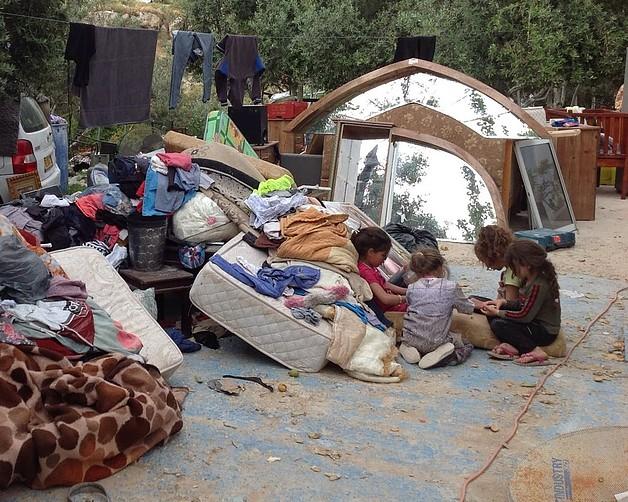 Children whose home in East Jerusalem was destroyed