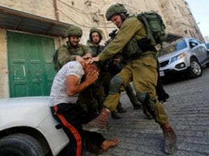 Hebron, Sept. 2016: Army claimed man was resisting arrest, but said an investigation will be opened (Reuters) Israeli authorities said the man was resisting arrest but launched an investigation after images showed troops holding his head down and kicked him, and a soldier kneeling on the man's head.