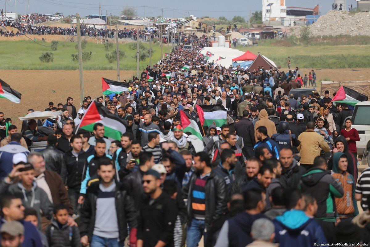Thousands of Palestinians assemble along the Gaza-Israel border to reaffirm the 'Right of Return' on 30 March 2018