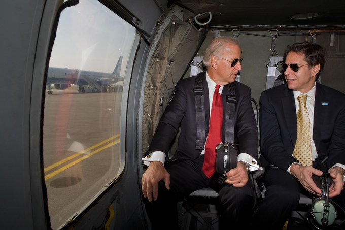 Joe Biden sits next to Tony Blinken in airliner