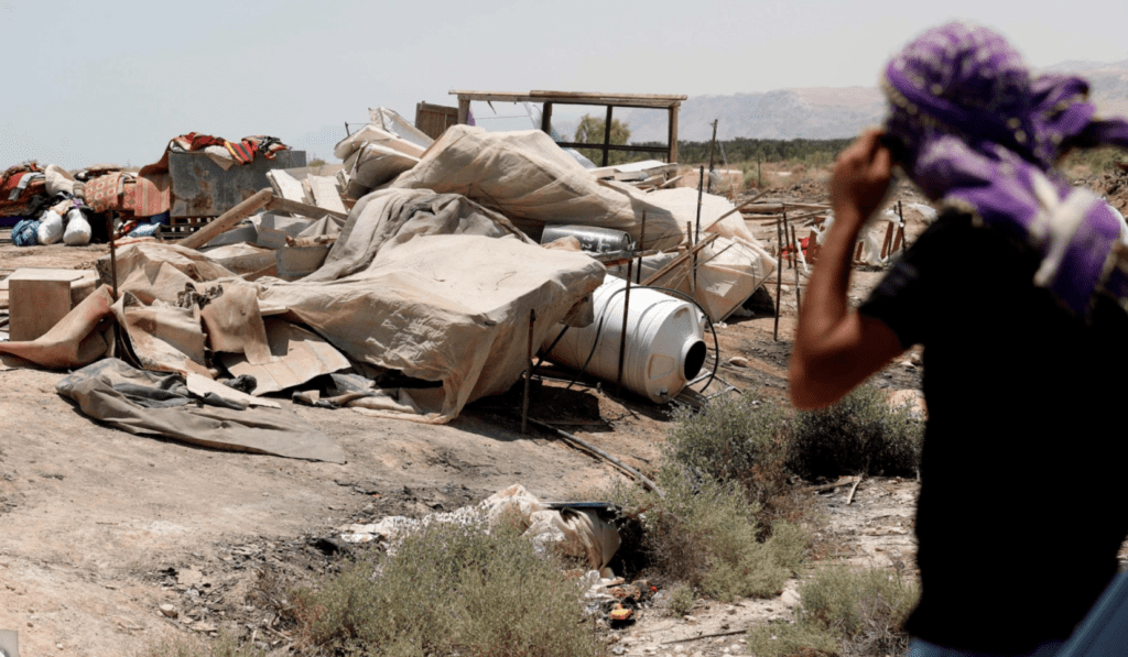 A Bedouin man looks at the rubble of a tent in the Deir Hajle Bedouin community, east of the Palestinian city of Jericho, June 3, 2020.
