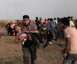 Do Jewish groups want equality for Gaza? Palestinian carries an injured child during a demonstration at the Gaza-Israel border fence, May 25, 2018.