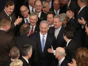 Israeli Prime Minister Benjamin Netanyahu is greeted by members of Congress as he arrives to speak during a joint meeting of the United States Congress in the House chamber at the U.S. Capitol March 3, 2015 in Washington, DC.