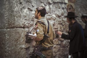 An Israeli soldier prays at the Western Wall as he awaits deployment to Gaza in 2008.