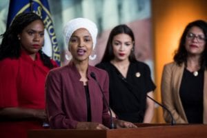 'The Squad,' with Representative Ilhan Omar at the podium, 2019, Washington