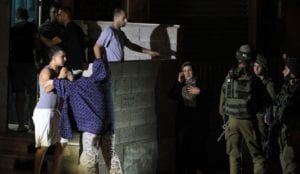 Israeli soldiers during a home invasion on the Jalazun refugee camp, June 16, 2014.