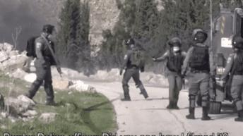 Israeli soldiers cheer after shooting Palestinian man