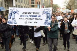 "group carries banner ""Jews won't be free until Palestinians are"" – protesting against Progressive Except Palestine"