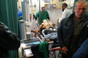 Harun Abu Aram seen in a Hebron hospital after being shot in the neck by an Israeli soldier.