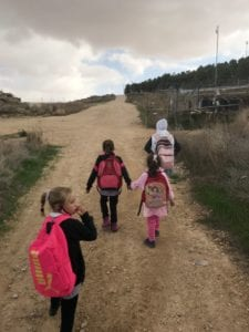 The Palestinian children walking home from school in At-Tuwani to Tuba.