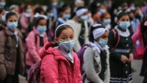 palestinian children wear masks at school