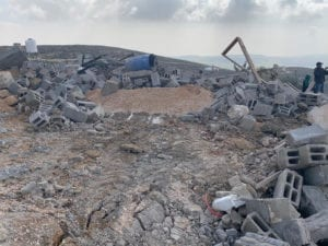 Israeli forces demolishing structures in the hamlet of Khalet al-Daba, in the occupied West Bank, March 2, 2021.
