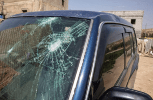 Settler violence: The family's SUV, which was damaged while children were inside.