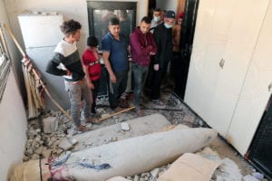 Palestinians look at an unexploded munitions dropped by In Israeli F-16 plane on a house in Khan Younis in the southern Gaza Strip on May 20, 2021. The US has built and sold F-16s to Israel as part of its policy of providing Israel with a Qualitative Military Edge (QME)