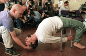 "Actors demonstrate the Israeli Shin Bet torture method known as ""Banana b'kiseh"""