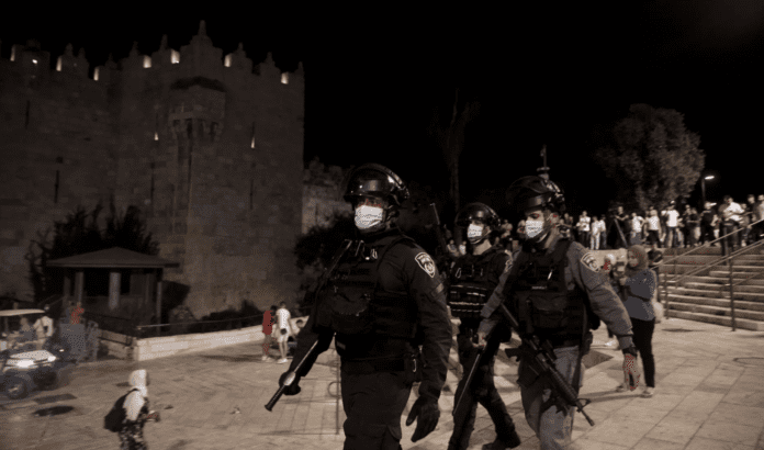 Israeli police officer beats Palestinian who complained about police violence